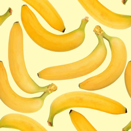 Abstract background of yellow bananas. Seamless pattern. Close-up.