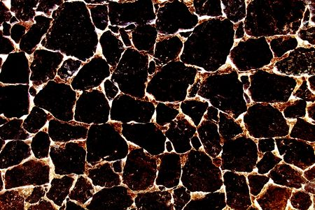 Burnt volcanic stone abstract textured background.