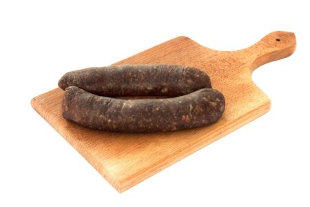 Raw,home made sausages on wooden chopping board isolated on white