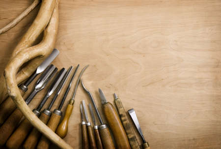 Set of chisels for woodcarving. Wooden background
