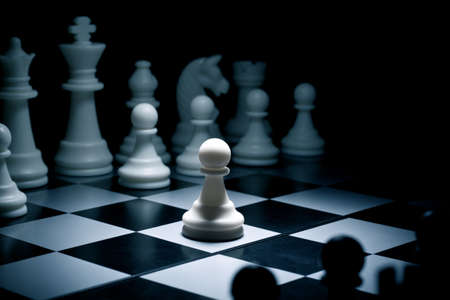 Chess. White go the first. The central figure-pawn