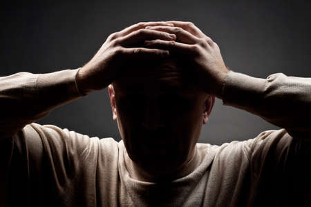 Portrait of the upset man against a dark background