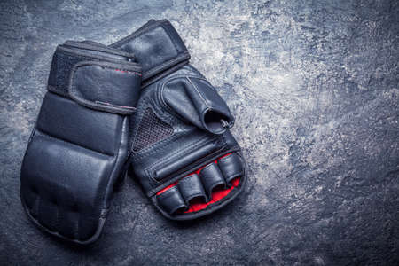 Foto de Mixed martial arts black gloves on gray background - Imagen libre de derechos