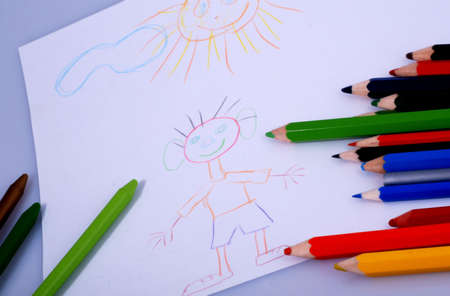 children\'s drawings and colourful crayons