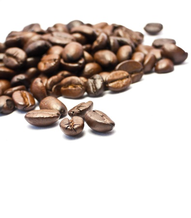 Coffee beans close-up on white background