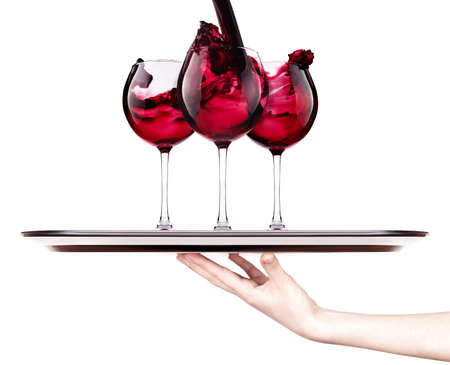 celebrate the holiday background - hand with red splashing wine on a silver tray