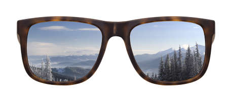 Trendy sunglasses with a reflection of a beautiful winter landscape isolated on white