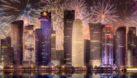 Beautiful fireworks above skyline of West Bay and Doha City, Qatar