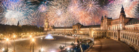 Foto de Beautiful fireworks above Spain Square on sunset, Seville - Imagen libre de derechos