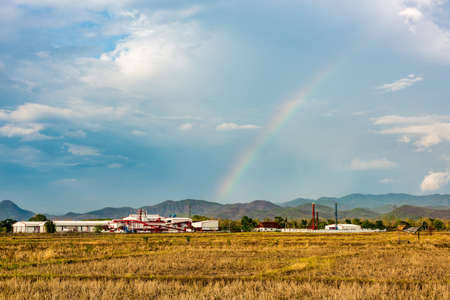 Rainbow over a manufacturing plant