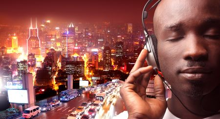 black man listening music with city view on the background