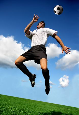 soccer or football  player in acrobatic position
