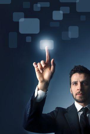 Photo pour Businessman pressing  a button of a touchpad - image libre de droit