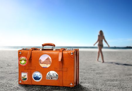 Photo for Suitcase and beautiful woman in swimsuit on the background - Royalty Free Image