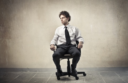 Young businessman sitting on an office chair