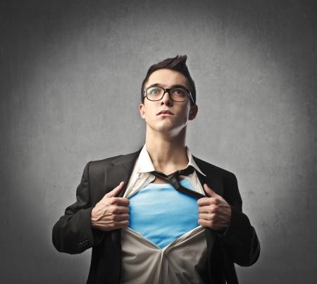 Businessman showing the superhero costume underneath his suit