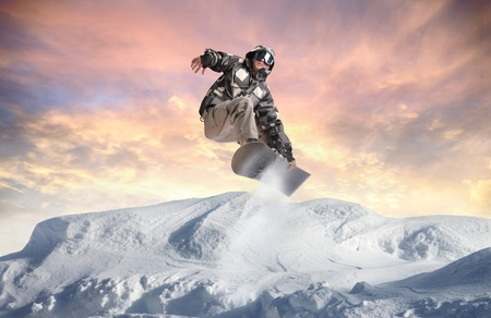 Young man snowboarding in the mountains