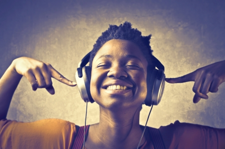 Smiling african woman listening to music
