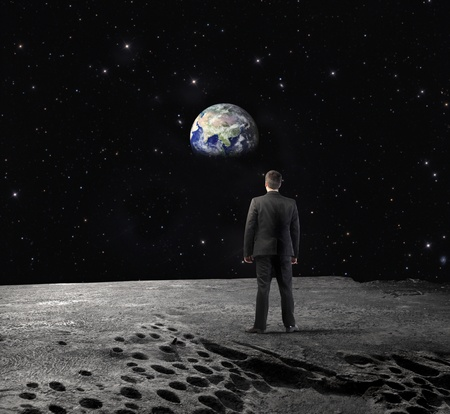 Businessman on the Moon looking at the Earth