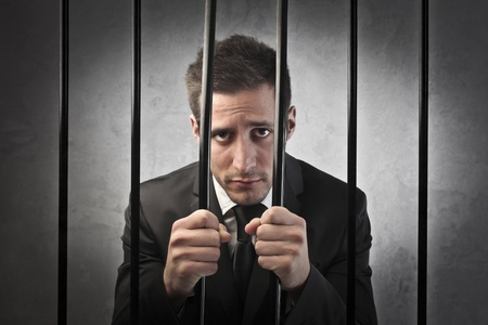 Sad businessman in prison
