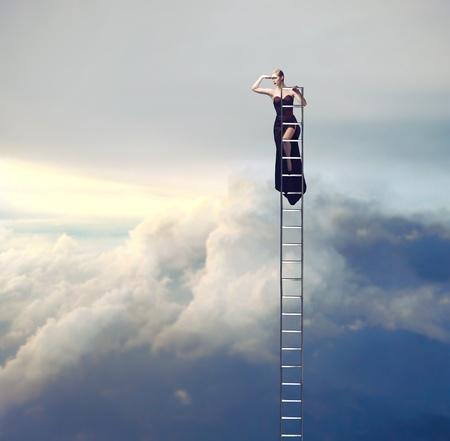 Beautiful elegant woman on a ladder looking far away
