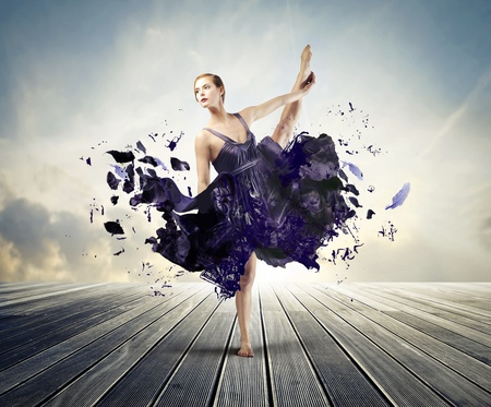 Foto de Beautiful ballerina with her dress melting away  - Imagen libre de derechos