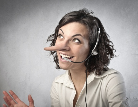 Smilng saleswoman with long nose talking on the telephone