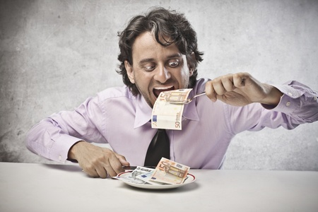 Businessman eating his earning