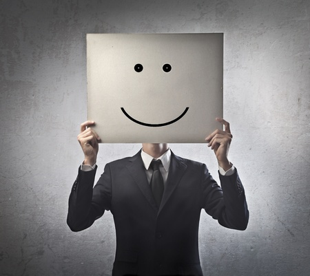 Businessman with smiley instead of the face