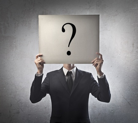Businessman with a question mark instead of the face