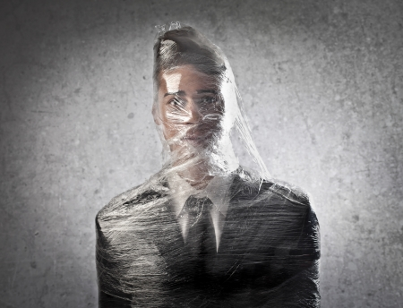 Businessman trapped in the plastic