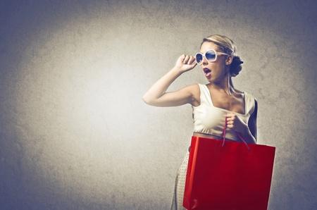 Blonde woman doing shopping