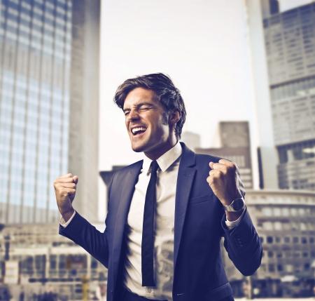 Businessman rejoicing in his success
