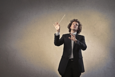 Photo pour Man conducting an orchestra - image libre de droit