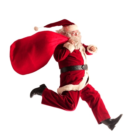 Santa Claus running with his sack full of presents