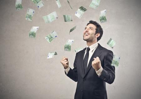businessman happy with his economic success