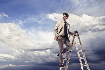 businessman on a ladder looking into empty