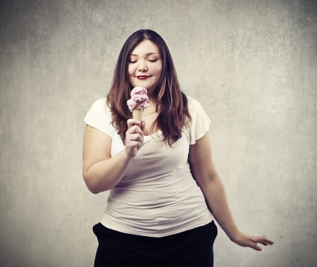 young fat woman looking icecream cone