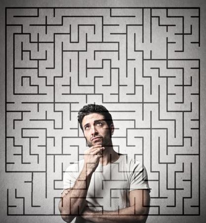 Photo pour young man thinks for the solution - image libre de droit