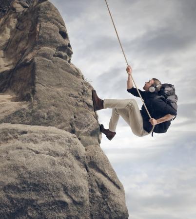 young man climbing the rocks