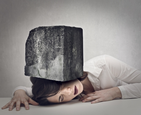 young woman with a big boulder above her head
