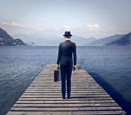 businessman surrounded by the lake and mountains