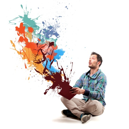 man opening a book and coming out paint