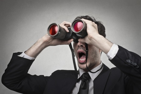 businessman looking at something with a binoculars