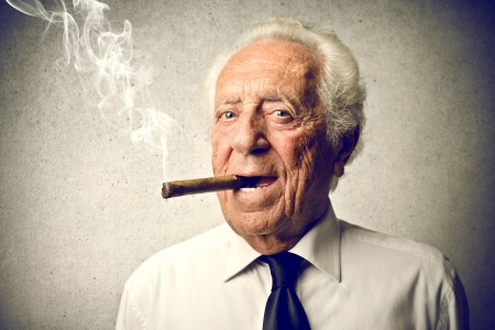old man smoking a cigar