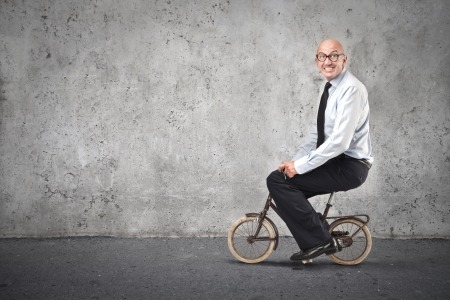 businessman riding a small bike