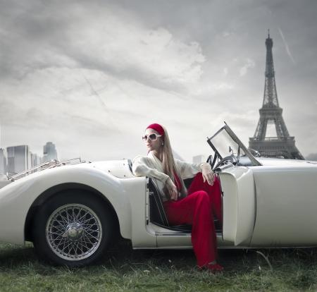 Foto de beautiful fashion woman on a car in Paris  - Imagen libre de derechos