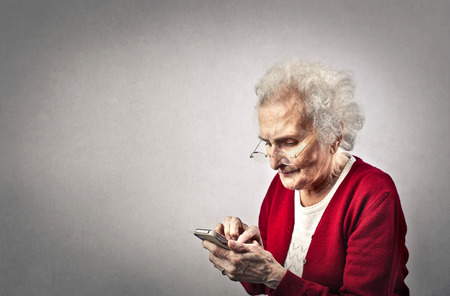 Photo pour Grandma texting - image libre de droit