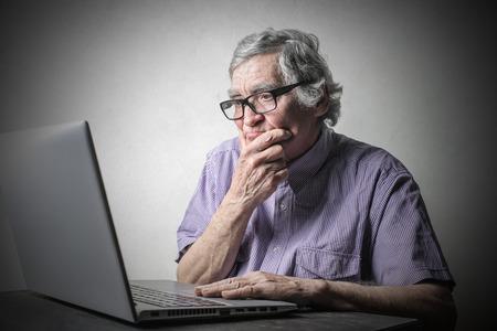 Doubtful man using a pc