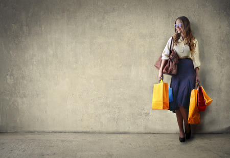 Woman carrying shopping bagsの写真素材